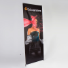 X-Banner esecuzione premium, 500g/m² PVC (classe d'incendio B1) per motivi alternanti con una superficie di presentazione visibile fino a 140  x 250 cm.